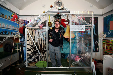 Stock Photo of Matt Whistler inside the greenhouse at the Julie-Anne Gilburt art gallery that he will be living in for 30 days