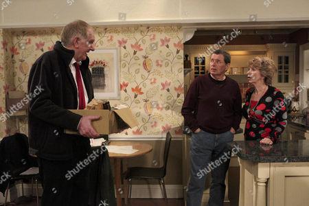 Diane Sugden [Elizabeth Estensen] and Charlie Haynes [George Costigan] share an intimate moment when Douglas Potts [Duncan Preston] comes in.
