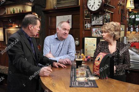Douglas Potts [Duncan Preston] annoyed when he sees that Diane Sugden [Elizabeth Estensen] is flattered by Charlie Haynes' [George Costigan] attention.