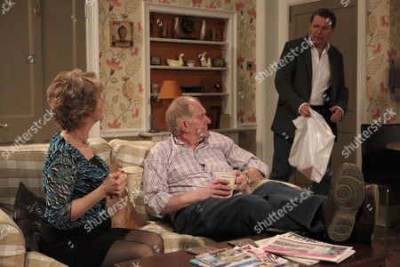 Douglas Potts [Duncan Preston] is annoyed when Charlie Haynes [George Costigan] interrupts their quiet moment with Diane Sugden [Elizabeth Estensen] He's back from France and has gifts.