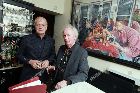 Film producer Stephen Evans and artist John Wonnacott at Bentleys Restaurant, Piccadilly , London