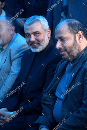 Stock Photo of Palestinian Prime Minister in Gaza Strip, Ismail Haniyeh greets the top Hamas armed commander Ayman Nofal upon his arrival to his home in Nusairat refugee camp in the Central Gaza strip