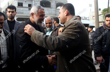 Stock Image of Palestinian Prime Minister in Gaza Strip, Ismail Haniyeh greets the top Hamas armed commander Ayman Nofal upon his arrival to his home in Nusairat refugee camp in the Central Gaza strip