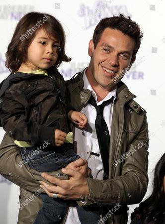 Stock Photo of Kevin Alejando & Family