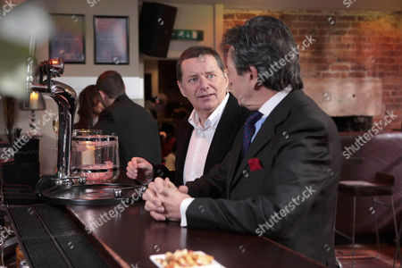 Rodney Blackstock [Patrick Mower] is delighted when he bumps into old friend Charlie [George Costigan].