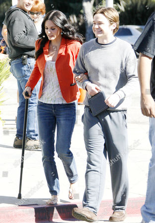 Courteney Cox Arquette with walking stick and Dan Byrd