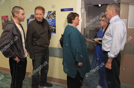 Aaron Livesy [Danny Miller], Hazel Rhodes [Pauline Quirke] and Jerry Walsh [Michael J Jackson] wait for news on Jackson's operation.