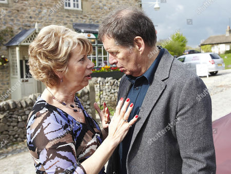 Diane Sugden [Elizabeth Estensen] tells Charlie Haynes [George Costigan] that she managed to get the loan.