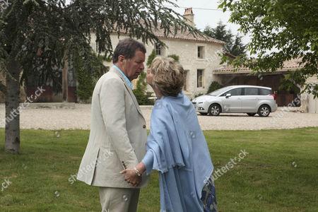 Diane Sugden [Elizabeth Estensen] leads Charlie Haynes [George Costigan] into the villa.