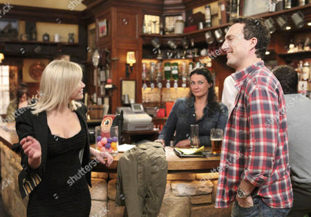 Moira Barton [Natalie J Robb] is amused by Eve Jenson [Susanne Shaw] flirting with John Barton [James Thornton].