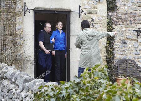 The border officers take Olena Petrovich [Carolin Stoltz] away as Eli Dingle [Joe Gilgun] has to be held back by Marlon Dingle
