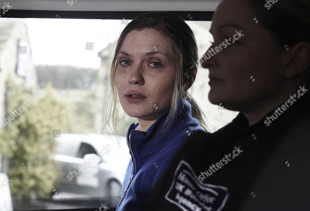 The border officers take Olena Petrovich [Carolin Stoltz] away