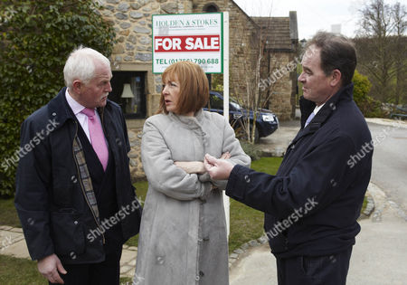Stock Photo of Terry Woods [Billy Hartman] tells Eric Pollard [Chris Chittell]  and Val Pollard [Charlie Hardwick]  that he's putting the B & B on the open market.