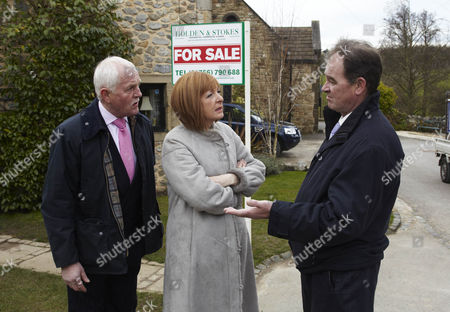 Stock Image of Terry Woods [Billy Hartman] tells Eric Pollard [Chris Chittell]  and Val Pollard [Charlie Hardwick]  that he's putting the B & B on the open market.