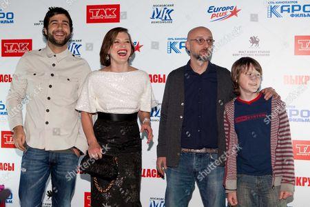 Stock Photo of Ivan Urgant, Milla Jovovich, Levan Gabriadze and Savva Gusev