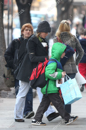 Cynthia Nixon with newborn son Max Ellington Nixon-Marinoni (inside her coat), her partner Christine Marinoni, and her son Charles