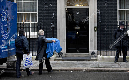 Battersea Dogs and Cats Home chief executive Claire Horton delivers Larry to number ten Downing Street