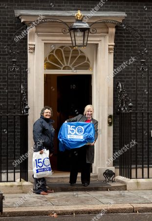 Kirsty Walker and Battersea Dogs and Cats Home chief executive Claire Horton deliver Larry to number ten Downing Street
