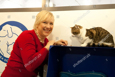Claire Horton, CEO of Battersea Dogs and Cats Home, with Larry at the Home