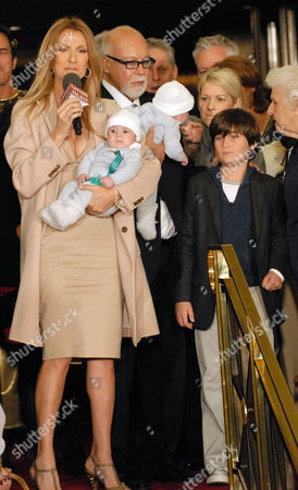 Celine Dion and husband Rene Angelil with twins Nelson and Eddy and son Rene-Charles and mother Therese, far right