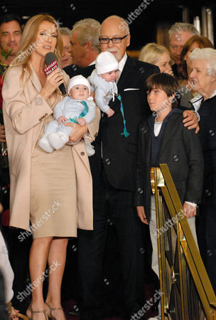Stock Picture of Celine Dion and husband Rene Angelil with twins Nelson and Eddy and son Rene-Charles and mother Therese, far right