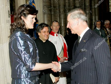 Prince Charles is introduced to Valda Wilson, soprano at Westminster Abbey