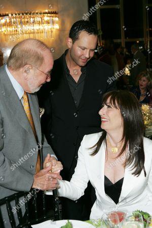 Gerome Pickman, Richard Weintraub and Anjelica Huston