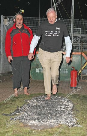 Former Mayor Ken Livingstone Former Mp Oona King Sarah Walters (flame Skirt) And Tanika Gupta Walk Across Smouldering Hot Coals To Raise Awareness For Womens Equality Organised By The Fawcett Group. Picture By: Nigel Howard Email: Nrhpixatyahoo.com Mobile   44 (0) 7831 235235 Usa   1 - 702 677 1839