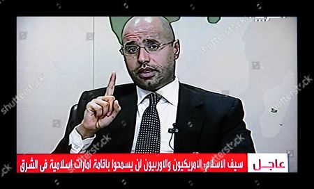 Stock Image of The son of longtime leader, Saif al-Islam Gaddafi appearing on Libyan state television