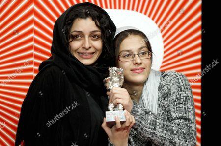 Iranian actresses Sareh Bayat (L) and Sarina Farhadi celebrate winning the Silver Bear for Best Actress