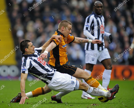 Paul Scharner of West Bromwich Albion and Jamie O'Hara of Wolverhampton Wanderers