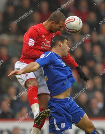 Marcus Tudgay of Nottingham Forest and Dekel Keinan of Cardiff City