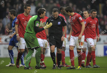 Nottingham Forest goalkeeper Lee Camp begs referee J Moss not to award the penalty