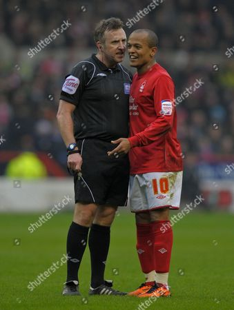 Referee J Moss and Robert Earnshaw of Nottingham Forest talk