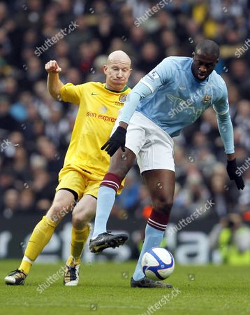 Yaya Toure of Manchester City and Lee Hughes of Notts County