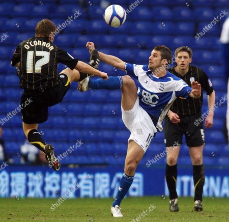 David Bentley of Birmingham City and James O Connor of Sheffield Wednesday in front of the empty stands at St Andrews.