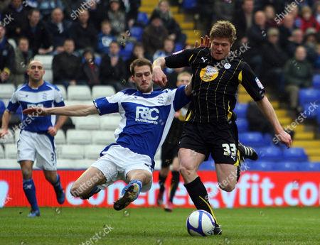 Neil Mellor of Sheffield Wednesday and Roger Johnson of Birmingham City
