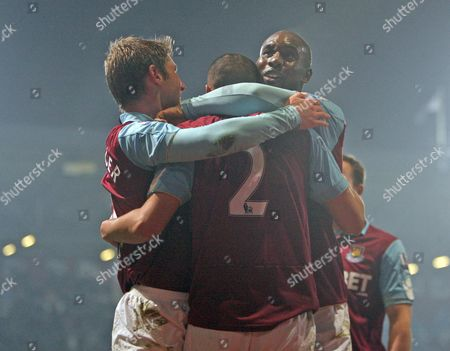 Stock Photo of Winston Reid of West Ham celebrates after scoring to make the score 4-0 with fellow goalscorers Carlton Cole and Thomas Hitzelsperger