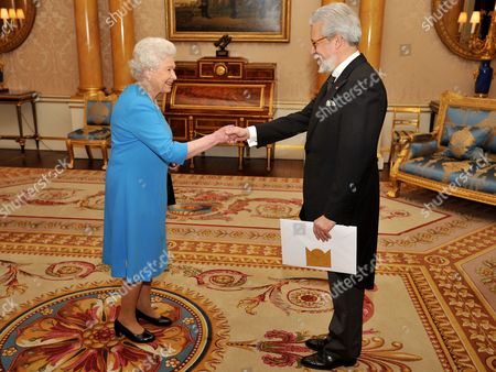 Her Majesty Queen Elizabeth II shaking hands with the Ambassador of Portugal Mr Joao de Vallera, before he presented his Credentials during a private meeting at Buckingham Palace