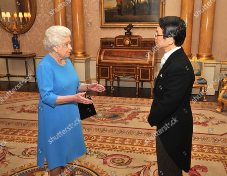 Her Majesty Queen Elizabeth II talks with the Ambassador of Japan Mr Keiichi Hayashi, after he presented his Credentials during a private meeting at Buckingham Palace