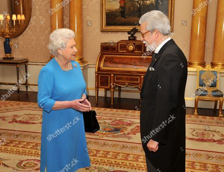 Stock Photo of Her Majesty Queen Elizabeth II talks with the Ambassador of Portugal Mr Joao de Vallera, after he presented his Credentials during a private meeting at Buckingham Palace