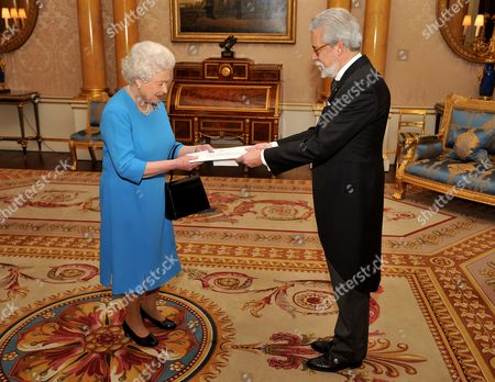 Stock Image of Her Majesty Queen Elizabeth II with the Ambassador of Portugal Mr Joao de Vallera, as he presents his Credentials during a private meeting at Buckingham Palace