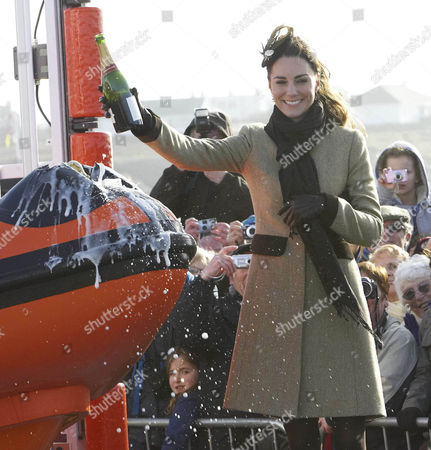 Kate Middleton pours champagne over the 'Hereford Endeavour',