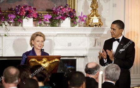 United States President Barack Obama applauds Governor Christine Gregoire, a Democrat from Washington, as she makes a toast