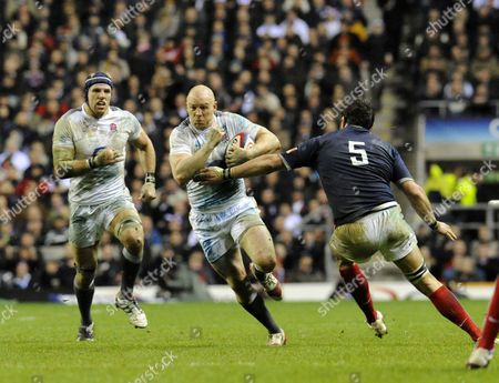 Stock Photo of Mike Tindall passing Lional Nallet
