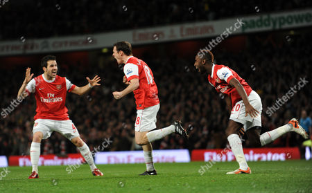 Sebastien Squillaci of Arsenal celebrates his goal with Cesc Fabregas and Johan Djourou making the score 1-0