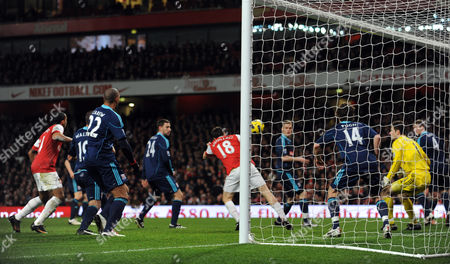 Sebastien Squillaci of Arsenal scores a goal with a header to make the score 1-0