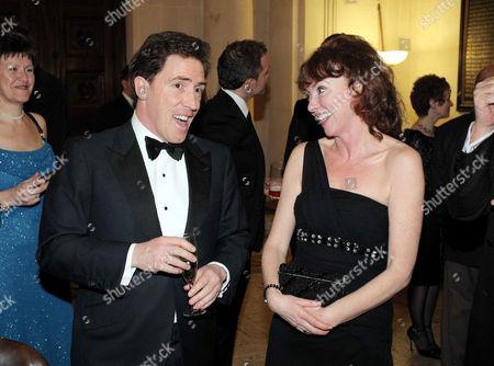Rob Brydon and Melanie Walters sharing a joke
