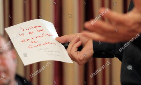 A note reading 'Julian is to be extradited to Sweden'