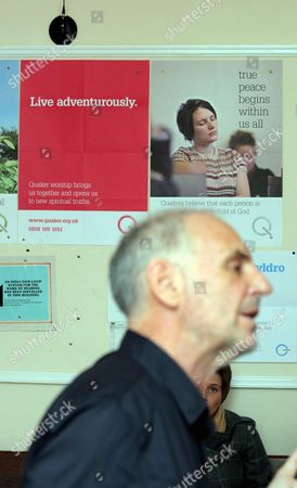 Dr Philip Nitschke seen against a wall with pro-Life and pro-Christian Quaker messages
